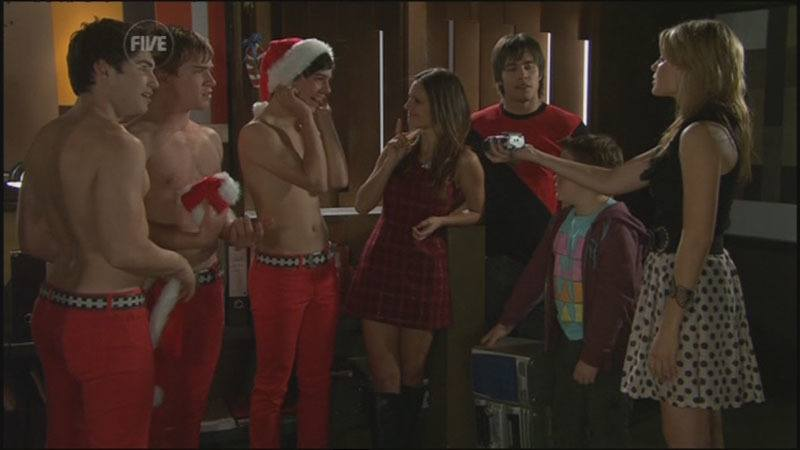 James Sorensen and Sam Clark in shirtless xmas outfit