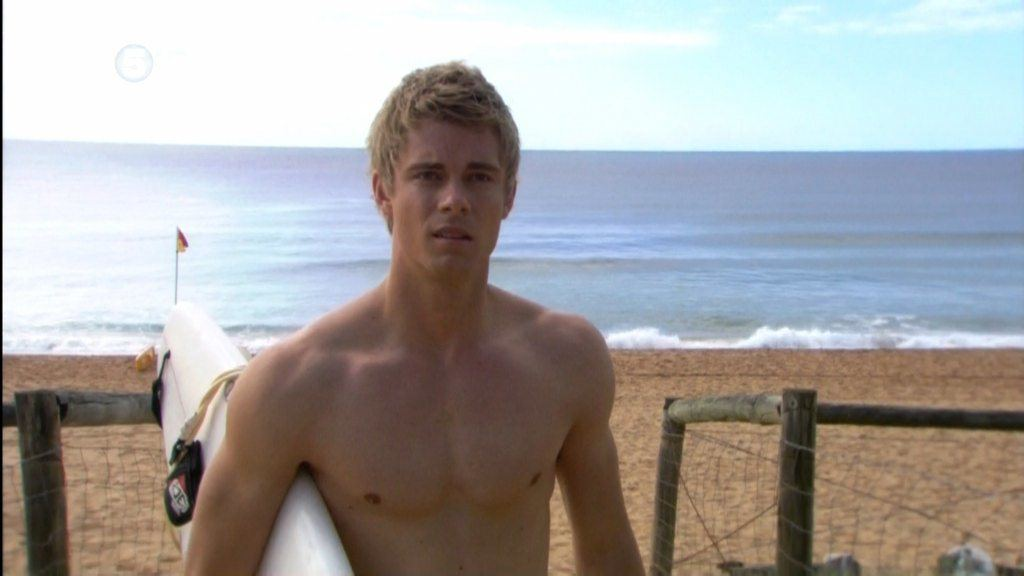 Luke Mitchell Shirtless At Beach image