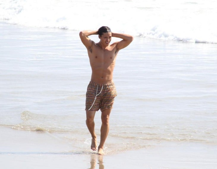 Booboo Stewart Shirtless At Beach image